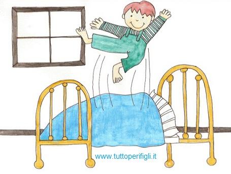 i bambini si divertono a saltare sul letto